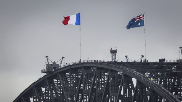 The French flag is raised alongside the Australian flag on the Sydney Harbour Bridge on Sunday.