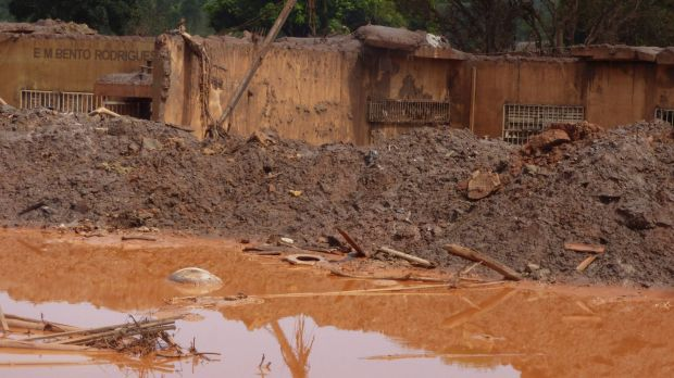 The dam burst sent a tsunami of mud and waste roaring out of the mine, killing at least 17 people.