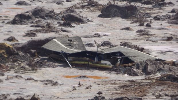 A farmhouse buried in mud in Bento Rodrigues after the BHP-Vale Samarco dam failure.