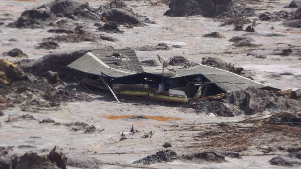 A farmhouse is buried in mud after the Samarco dam failure. BHP revealed that the death toll from the disaster had risen ...