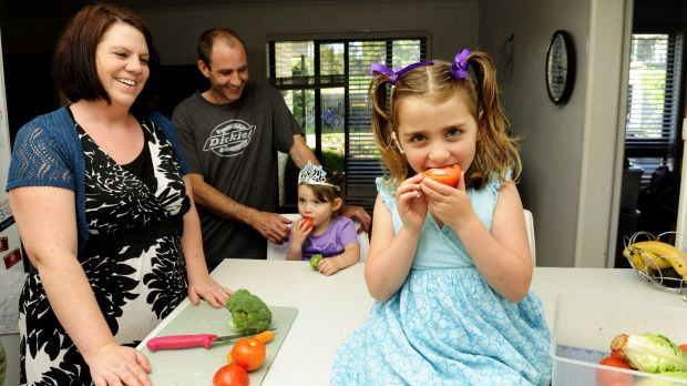 The Harvey family, from left, Ngaire, Chris, Imogen, 3, and Aisha, 5, at home in Kambah. They encourage their children ...