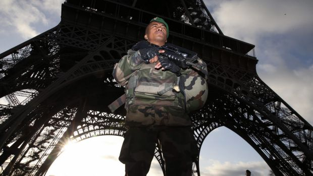Armed military patrol the Eiffel Tower Paris France on Sunday 15 November 2015.