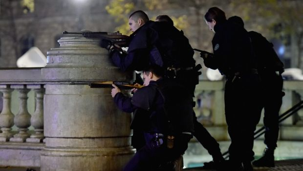Armed police are deployed in Paris at the Place de la Republique.