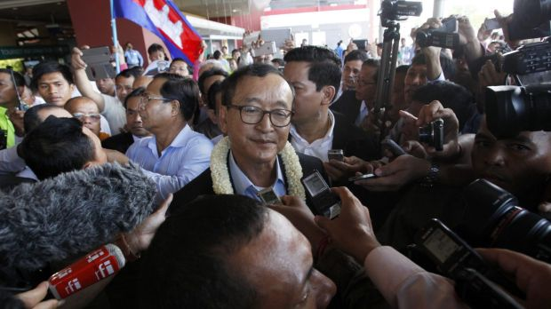 "Cambodian opposition leader Sam Rainsy has said he ""absolutely must go back to rescue our nation""."