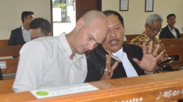 Australian Joshua Ronald Terelinck with his lawyer, Erwin  Siregar.