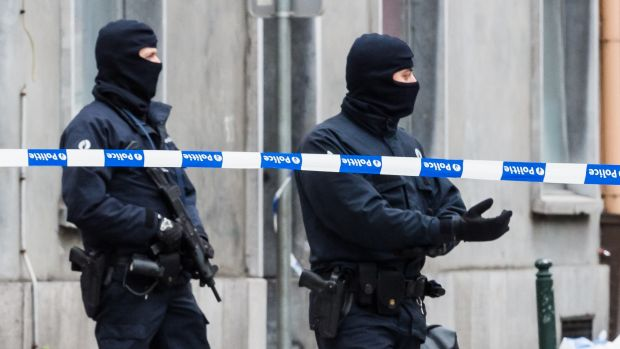 Armed police guard a street in Brussels on Monday, Nov. 16, 2015. A major action with heavily armed police is underway ...