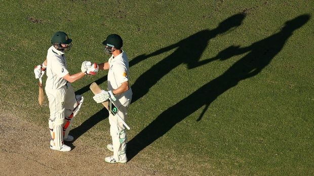 Steven Smith is congratulated by Adam Voges after scoring his century during day four of the second Test match between ...