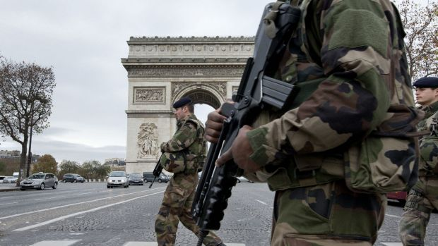French soldiers cross the Champs Elysees avenue in Paris.