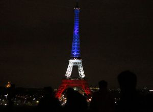 The Eiffel Tower is illuminated in the French national colours.