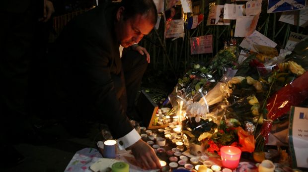 Josh Frydenberg placed flowers and lit a candle at the Bataclan memorial in Paris during a recent visit.