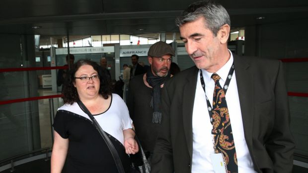 Emma Parkinson's mother Lisa is greeted by an Australian Embassy official on arrival in Paris en route to the hospital ...