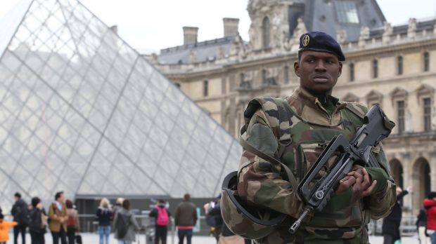 French military patrol the Louvre in Paris.