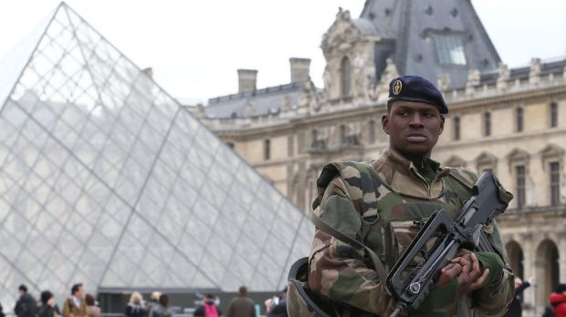 French military patrol the Louvre.