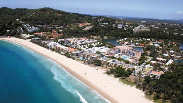 Authorities are still searching for a man seen swimming into the ocean from Noosa's Main Beach after midnight on ...