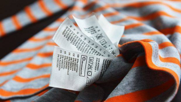 Clothing Care tags on one clothing item.