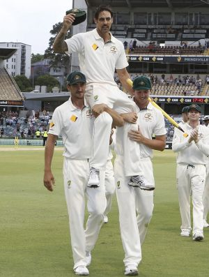Johnson is chaired off the ground by fellow fast bowlers Mitch Starc and Josh Hazlewood.