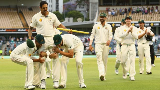 Mitchell Johnson's teammates, Mitch Starc and Josh Hazlewood, get ready to chair their retiring colleague off the field.