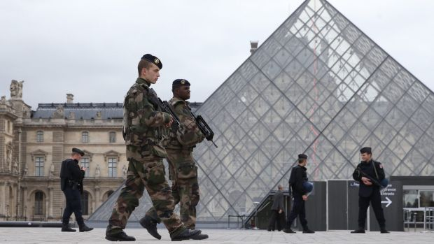 French military and police patrol the Louvre in Paris
