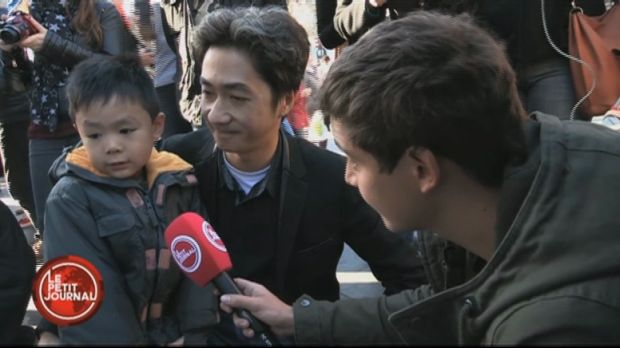 Brandon and his father, Angel Le, are interviewed by a reporter for French TV show <em>Le Petit Journal</em>.