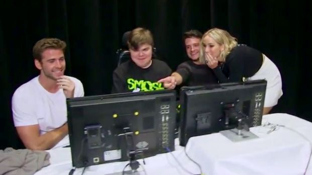 Liam Hemsworth, Dylan Miceli-Nelson and Josh Hutcherson with Jennifer Lawrence after their prank on Smosh during an ...