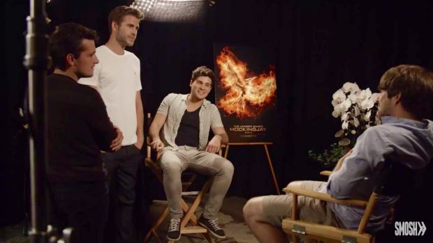 Liam Hemsworth and Josh Hutcherson stand over the Smosh team after Jennifer Lawrence's prank during an interview for ...