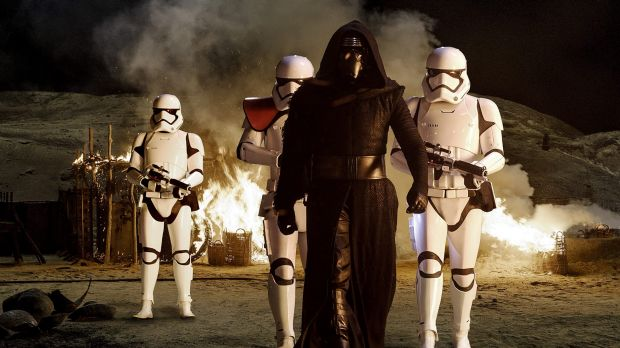 A scene from <i>Star Wars: The Force Awakens</i> featuring Kylo Ren (Adam Driver) with stormtroopers.