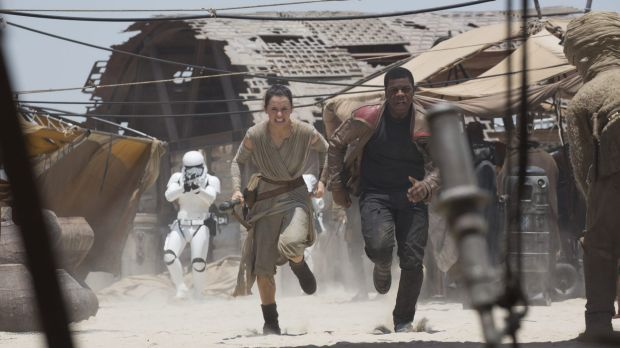 Rey (Daisy Ridley) and Finn (John Boyega) in <i>Star Wars: The Force Awakens</i>.