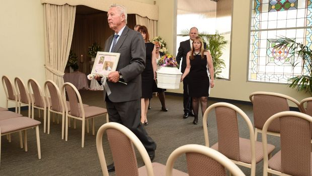 Funeral director Peter Elberg (left) leads the coffin containing the remains of Khandalyce Pearce at Peter Elberg ...