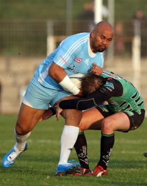 Twilight years of his career: Jonah Lomu is tackled by Montmelian's Guillaume Cognard, during their Federale One rugby ...