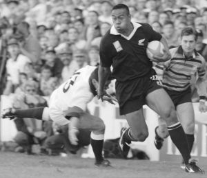 On the rampage: New Zealand winger Jonah Lomu moves past England's Will Carling on his way to score the opening try in ...