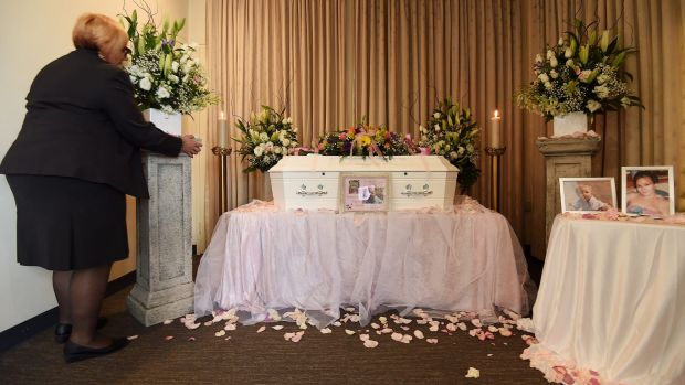 Carmel Costanzo of Peter Elberg Funerals makes final preparations near the coffin containing the remains of Khandalyce ...
