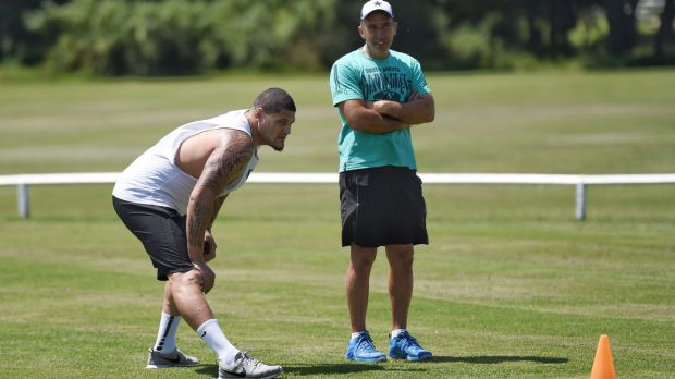 No rest for the Willie: Former NRL player Willie Mason takes a breather at sprint training with coach Roger Fabri in ...