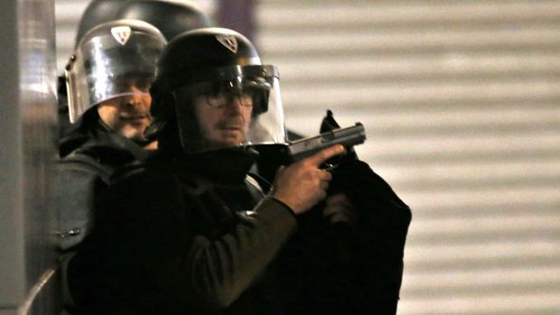 Armed police officers take up positions in Saint-Denis, Paris, early on Wednesday morning.