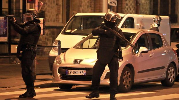 Police officers take up positions in Saint-Denis, a northern suburb of Paris on Wednesday.
