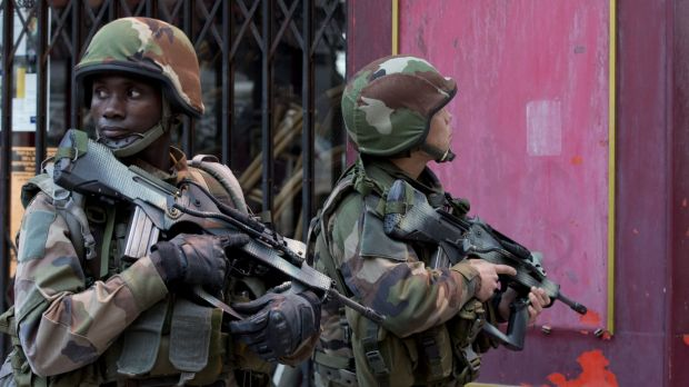 French soldiers take up position in Paris suburb Saint-Denis on Wednesday.