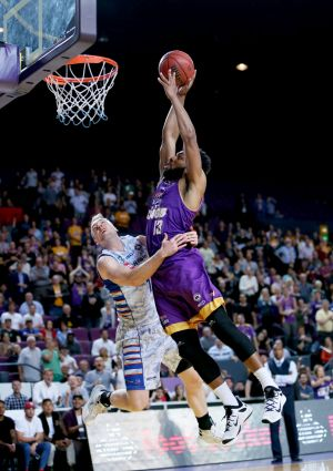 High flyer: Sydney's Dion Prewster goes up for a dunk against Adelaide.
