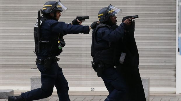 Police during the siege in Saint-Denis on Wednesday. At least two people were killed in the operation.