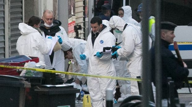 Forensics officers outside 8 Rue du Corbillon in Saint-Denis, Paris, on Wednesday. The bodies of Abdelhamid Abaaoud and ...