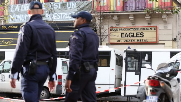 Police patrol Boulevade Voltaire in front of the Bataclan concert hall where the Eagles of Death Metal played last ...