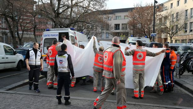 Medical staff transfer people to hospital after the Saint-Denis shootout.