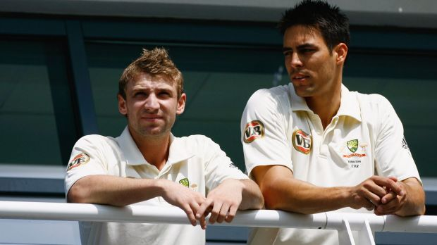 Mates: Hughes and Mitch Johnson look on from the balcony  during day one of the first Ashes Test in Cardiff in 2009.