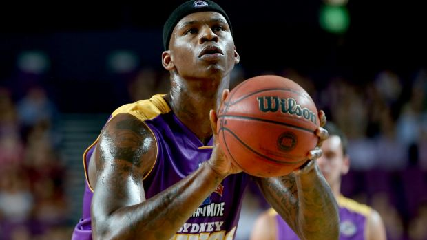 Game over: Al Harrington lines up a shot during his farewell game for the Kings.
