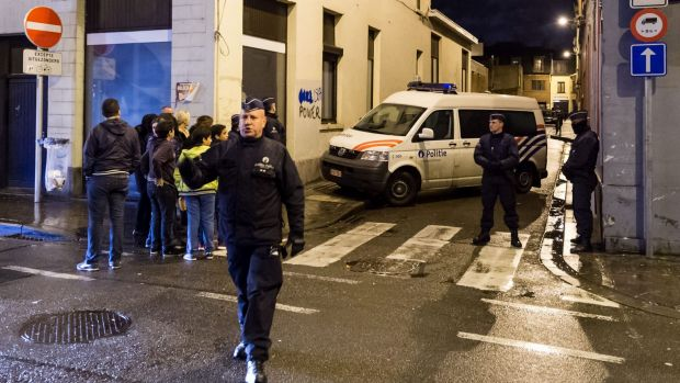 Police search a house in the Molenbeek neighborhood of Brussels on Tuesday.