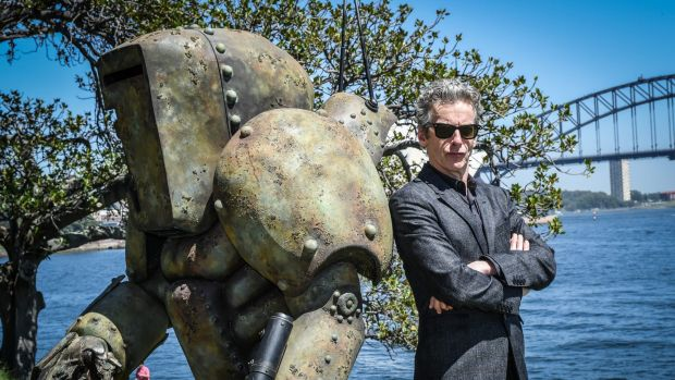 <i>Doctor Who</i> star Peter Capaldi and a mire, a monster from season 9, on Friday.