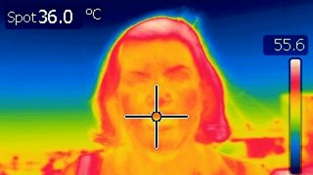 Reporter Catherine Armitage stays at a cool 36 degrees  on the infrared camera.