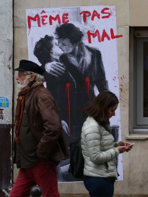 """Posters of lovers with bullet wounds and the statement """"not even hurt"""" have appeared in Paris."""