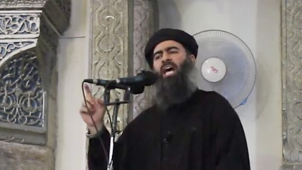 This image made from video posted on a militant website on July 5, 2014,  purports to show the leader of IS, Abu Bakr ...