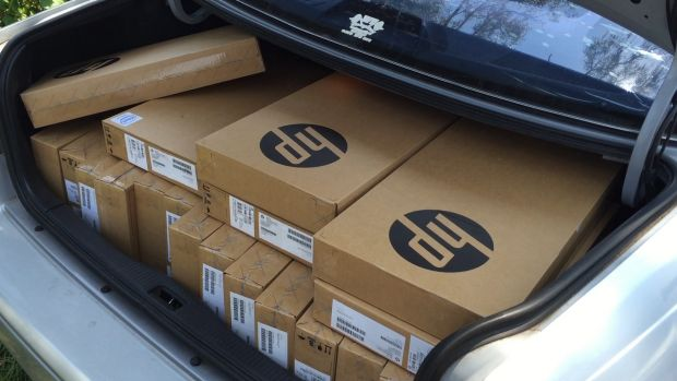 A car boot full of new laptops ready for delivery for new vocational students.