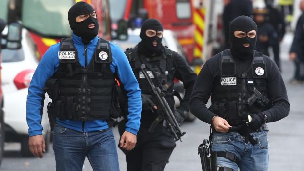 Military and police conduct an operation in Saint-Denis on Wednesday.
