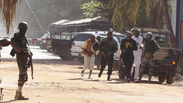 Hostages flee the Radisson Blu hotel in Mali. The man in the black suit is reportedly Guinean singer Sekouba Bambino, ...